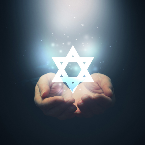 Two hands holding a Star of David