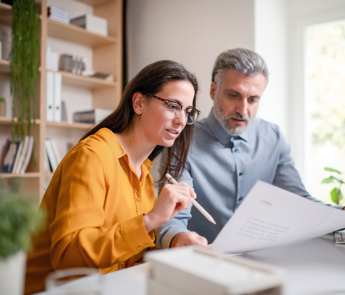 couple reviewing items on computer
