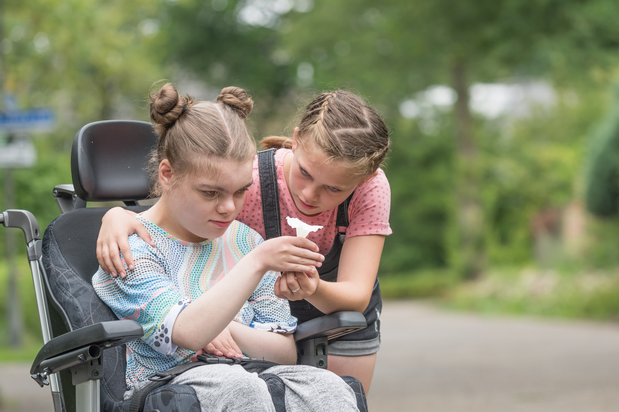 Two kids - one in a wheelchair