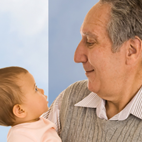 Grandfather looking lovingly at baby