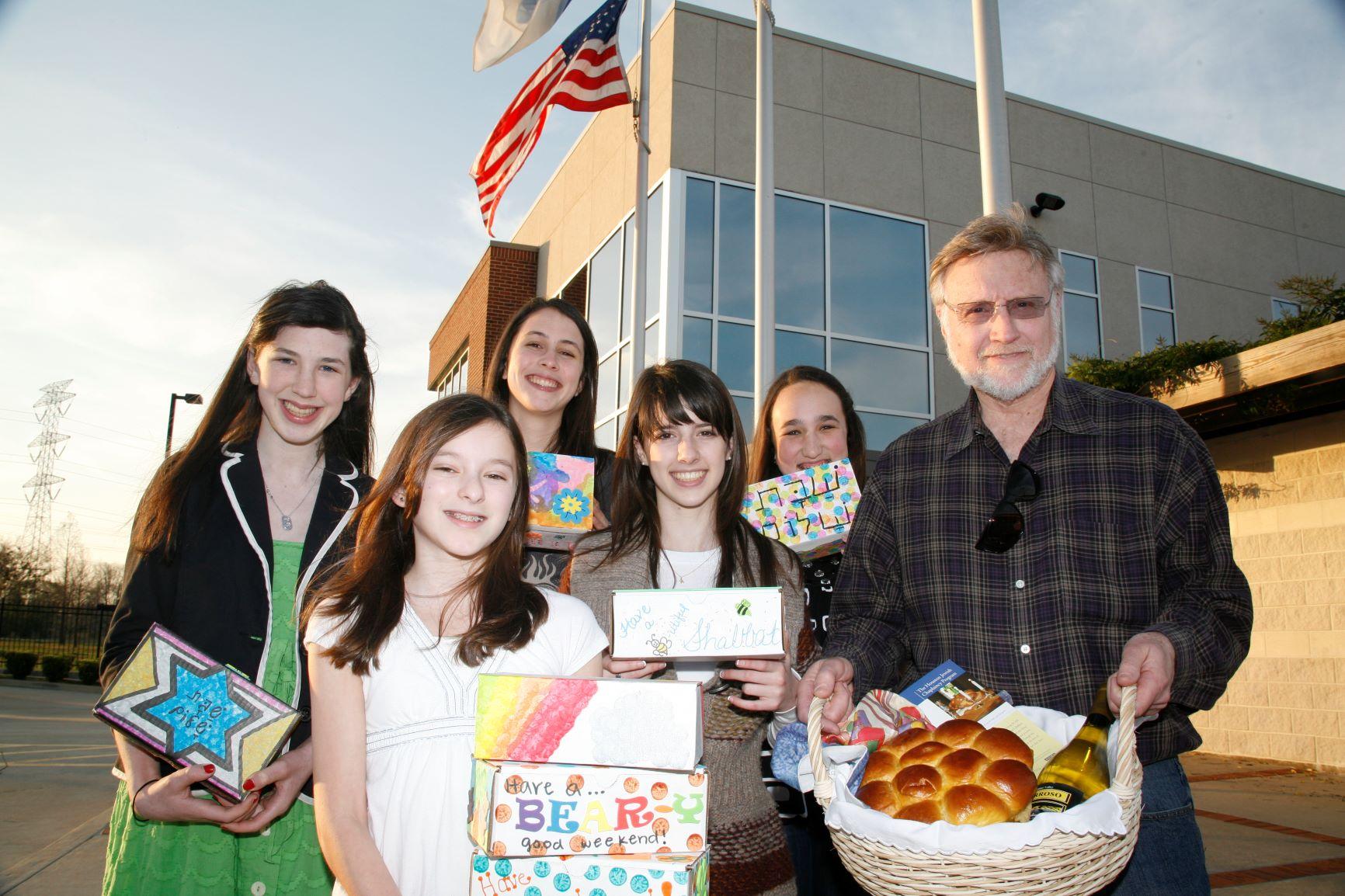 Family delivering Shabbat Boxes