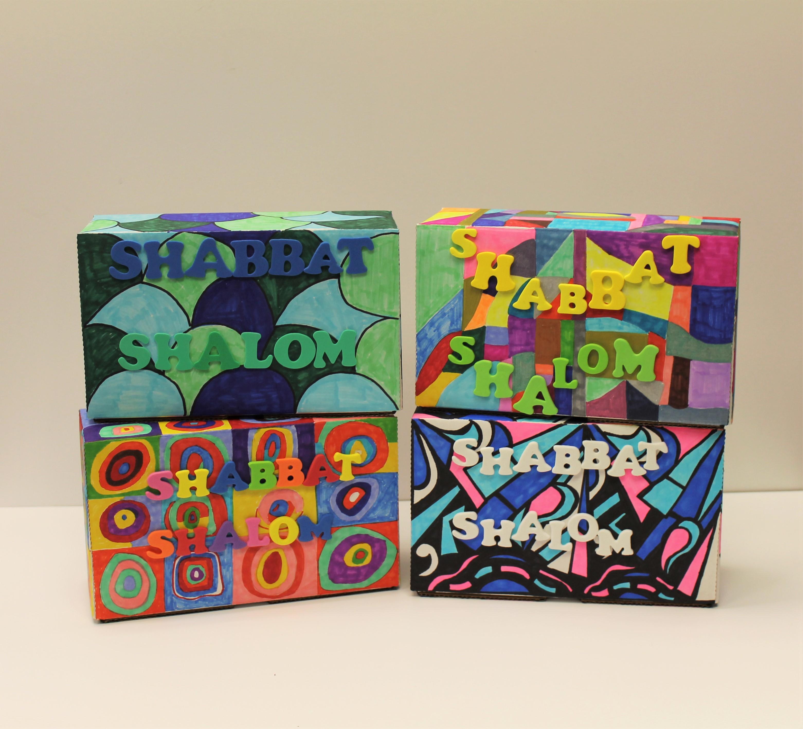 beautifully designed stack of shabbat boxes