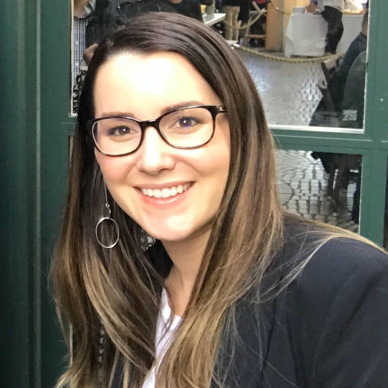 A photo of Elizabeth Swaminathan, Director of Sales Engineering at Amino