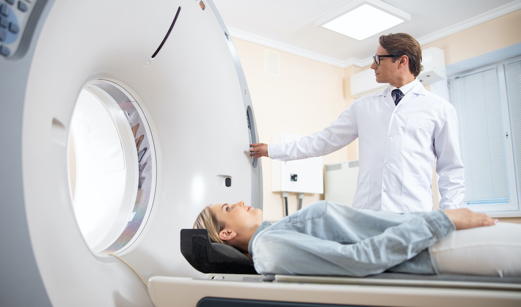 Photo of a woman undergoing a CT scan