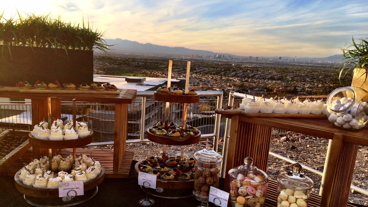 Food display on risers with city of Las Vegas in background