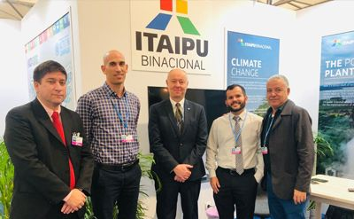 IHA's Chief Excutive Richard Taylor (centre) with representatives of Itaipu Binacional at COP24.