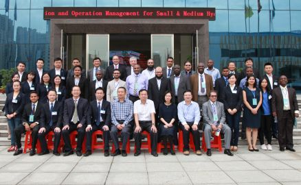 Photograph of workshop participants outside HNAC Technology Co. Ltd's International Technology Exchange Center