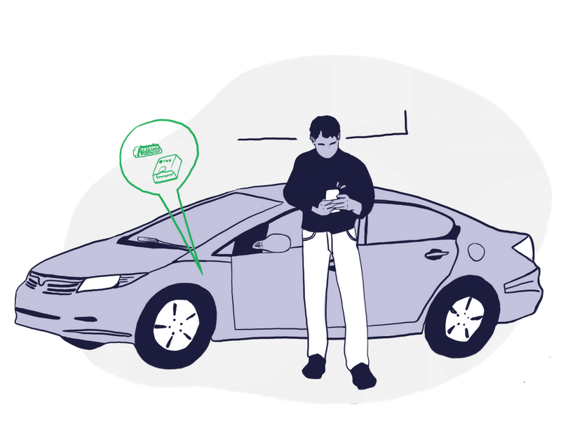 Man in front of car looks at phone