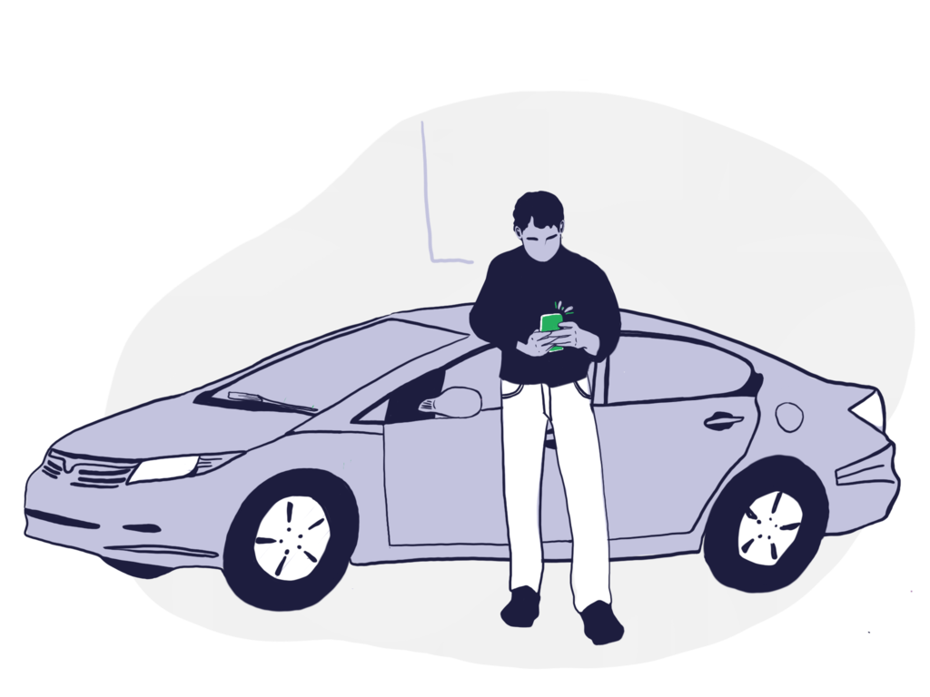 A man in front of his car looking at his vehicle's maintenance alerts on his phone