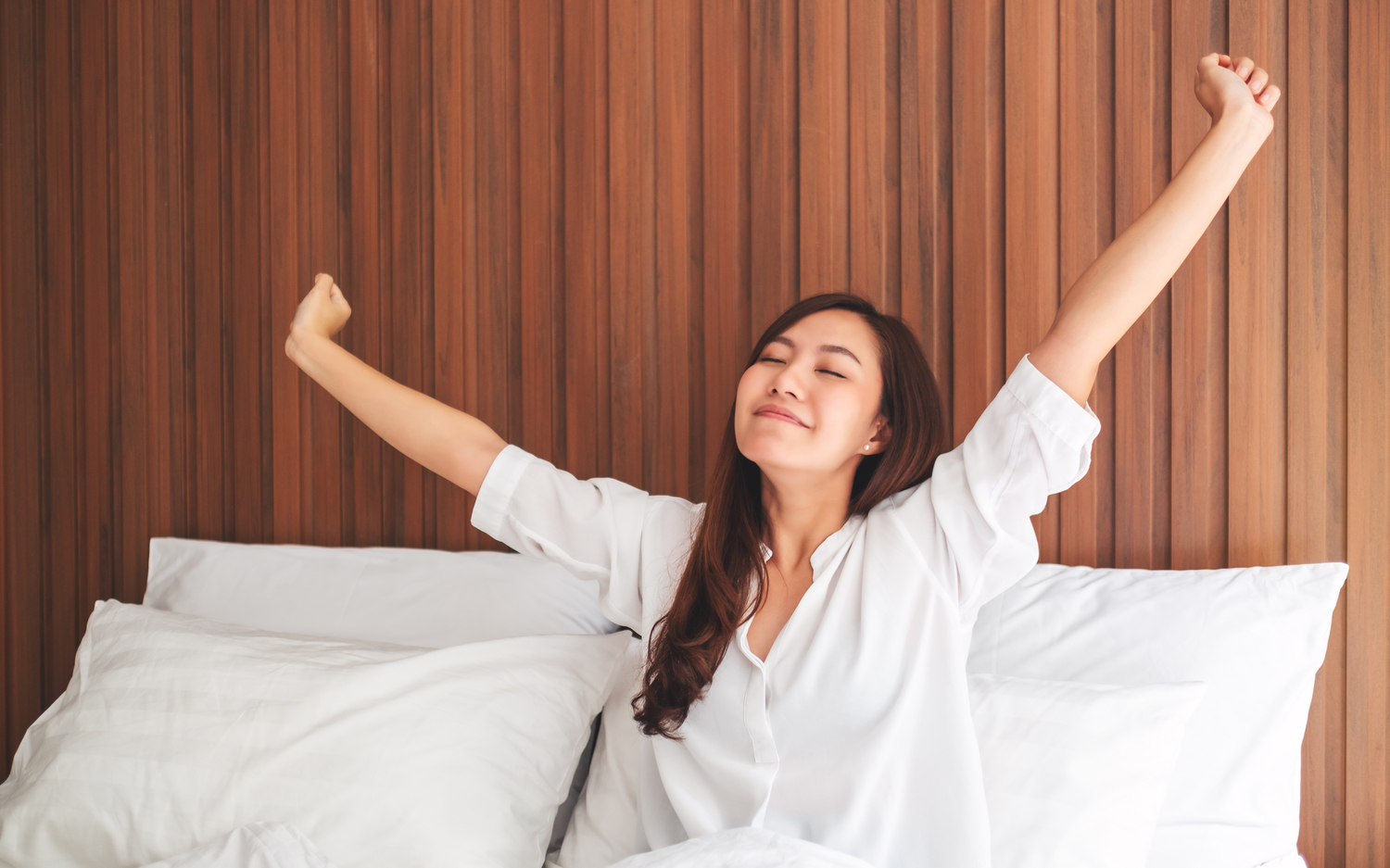 young woman waking up and doing stretches