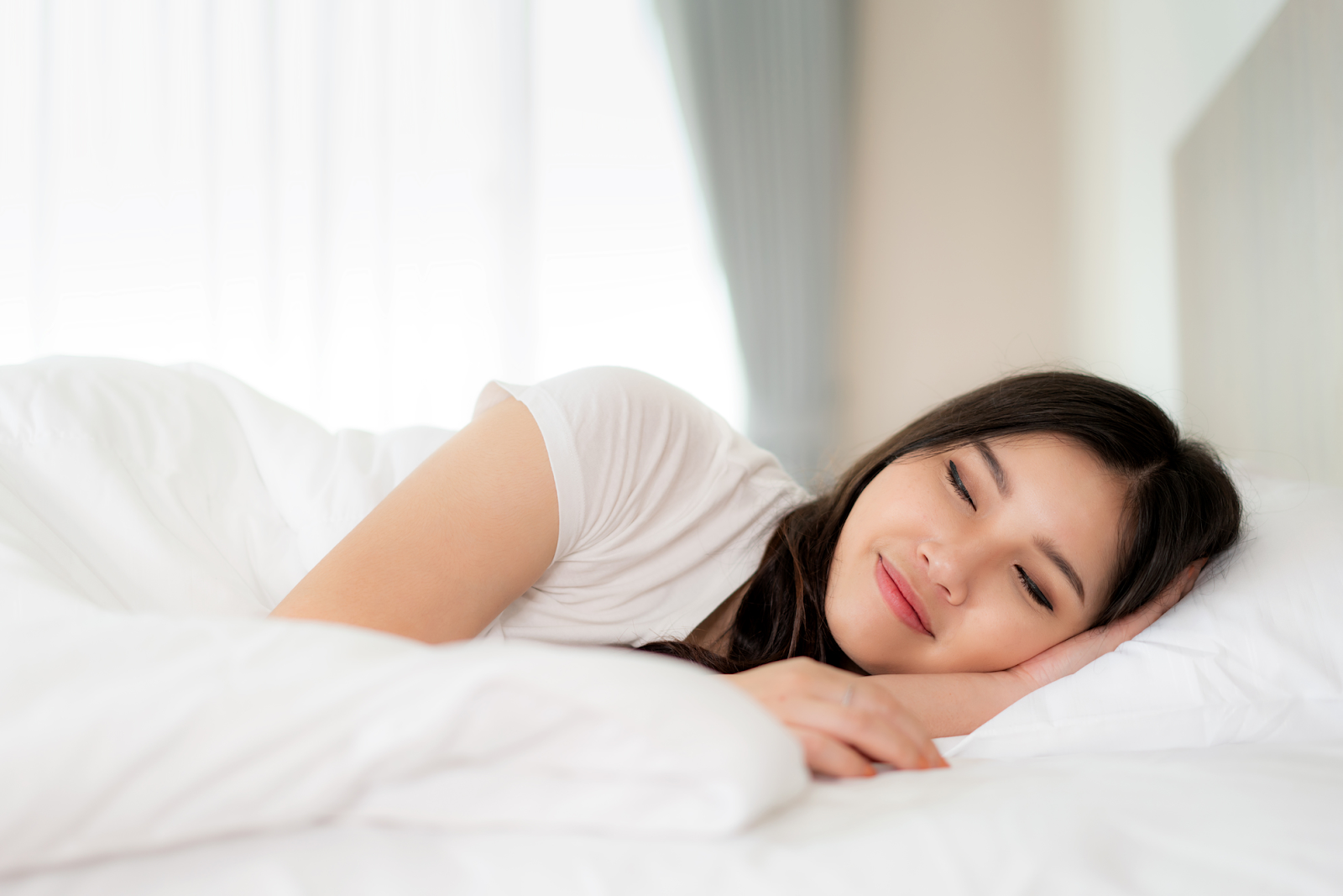 young woman sleeping peacefully on bed