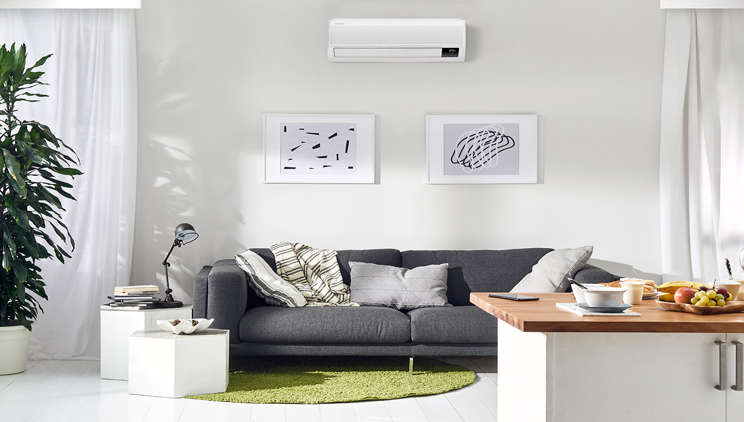clean living space with samsung aircon mounted on the wall