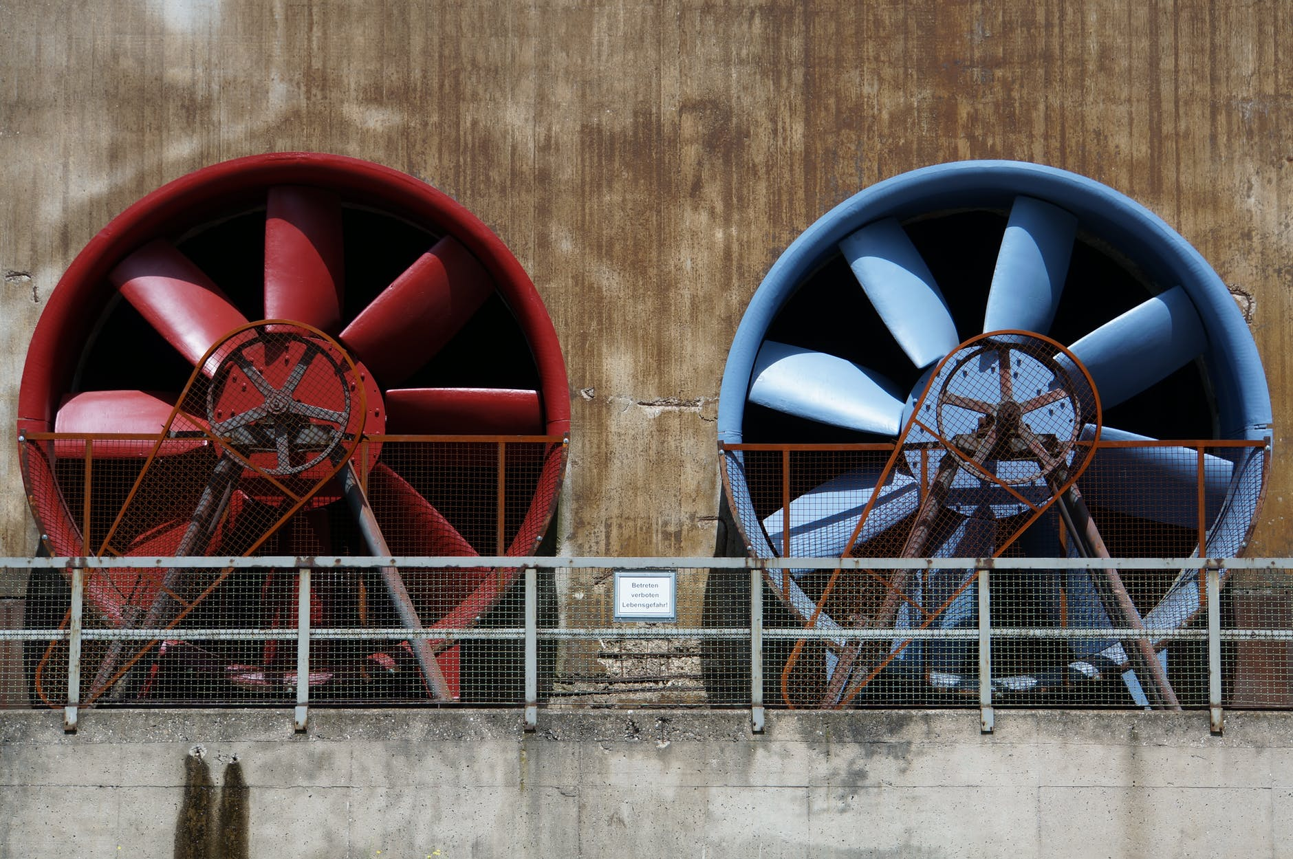 Industrial cooling fans in red and blue