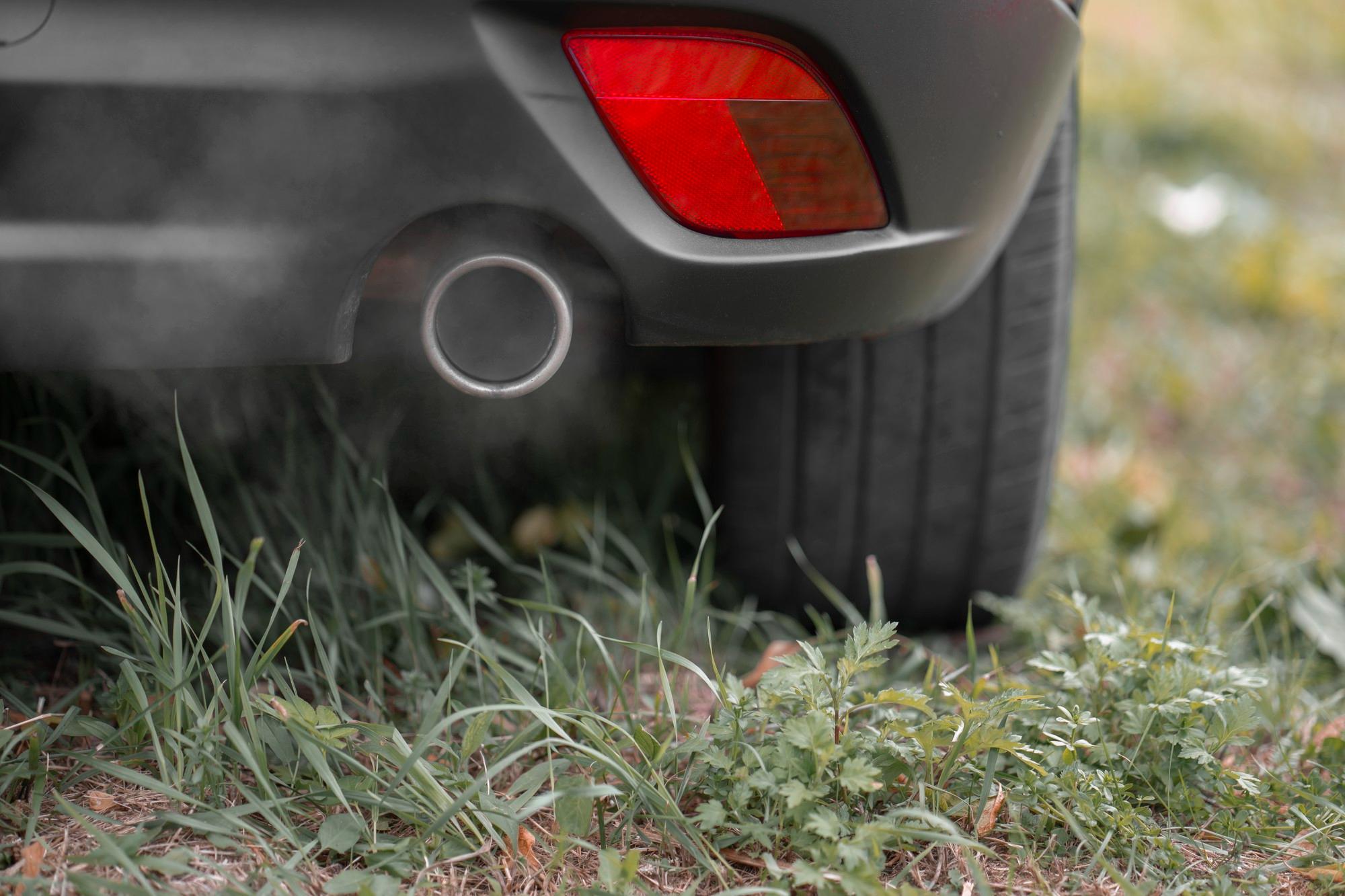 Exhaust of car emitting smoke