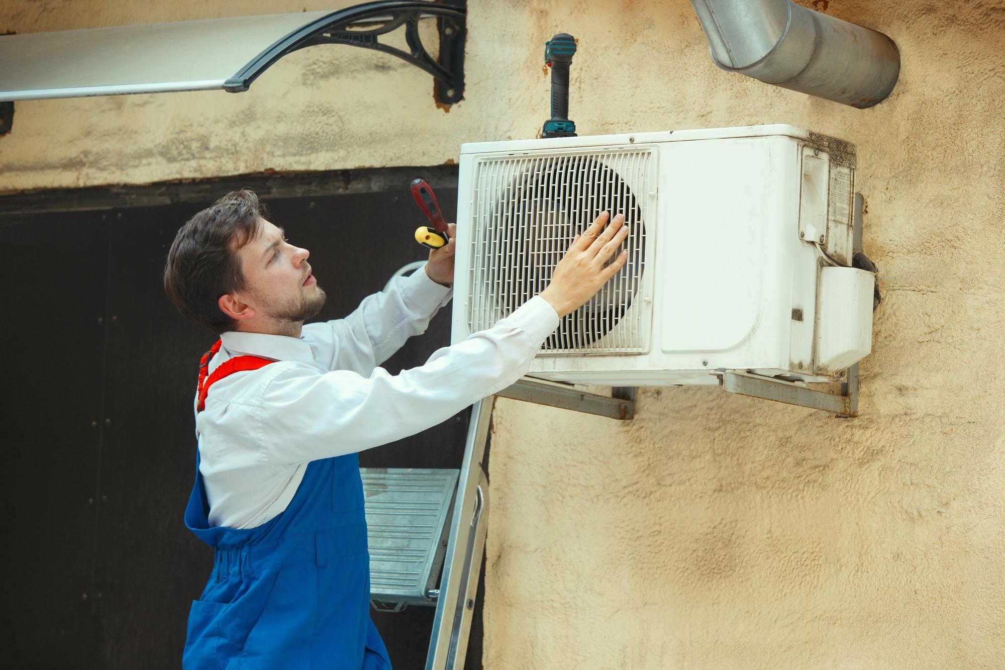Man evaluating outdoor AC unit