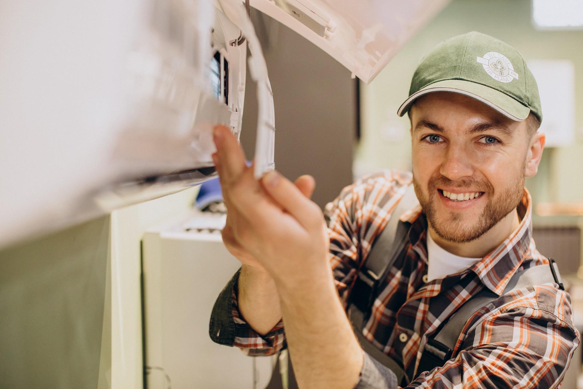 smiling man removing aircon filter