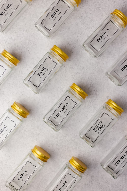 Set of 12 Black printed spice jars with gold lid