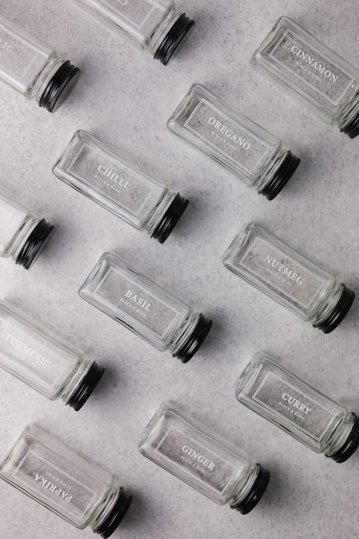 Set of 12 white printed spice jars with black lid
