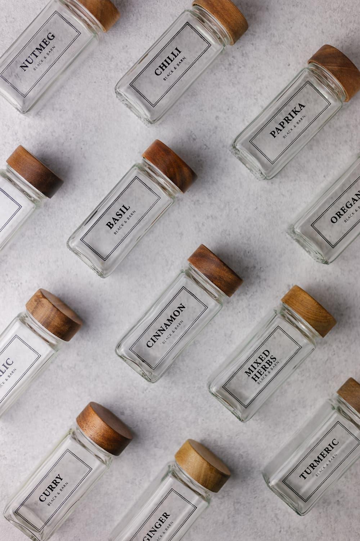 Set of 12 Black printed spice jars with wooden lid