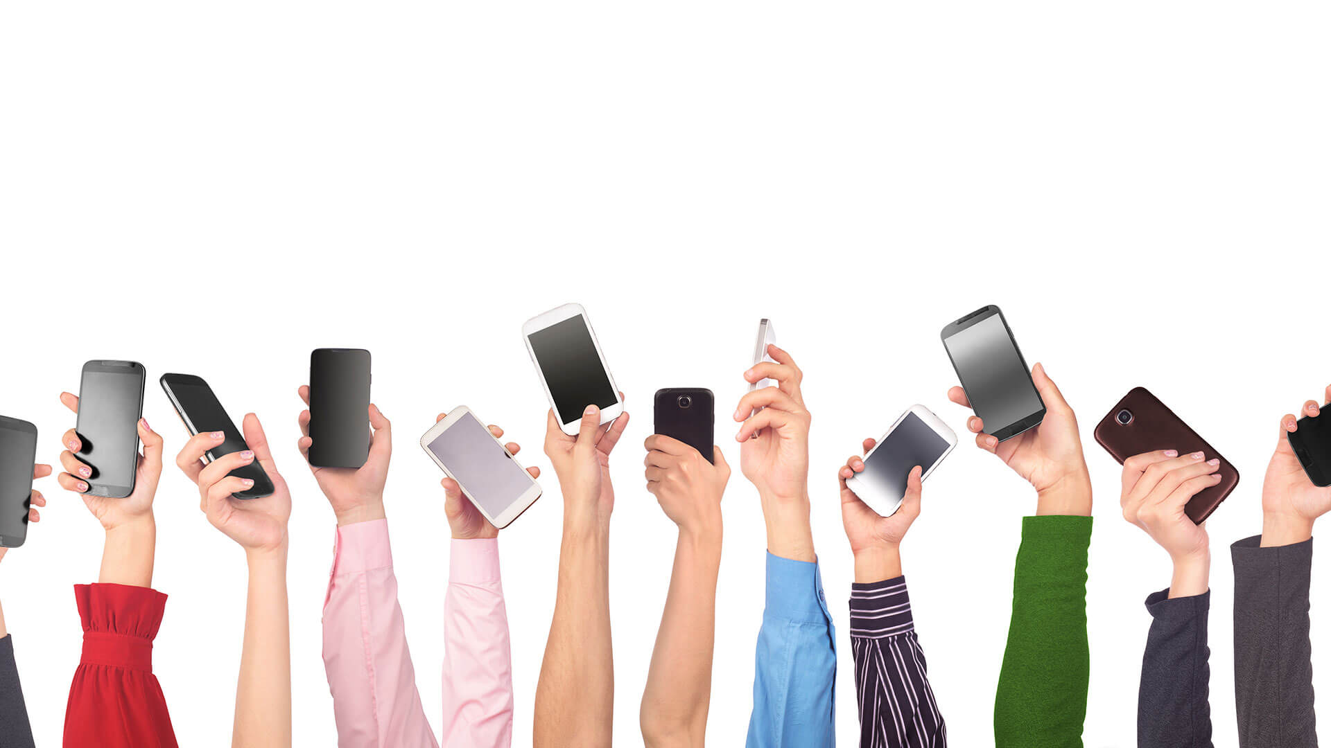 A group of individuals each holding up a smartphone (photo shows arms only).