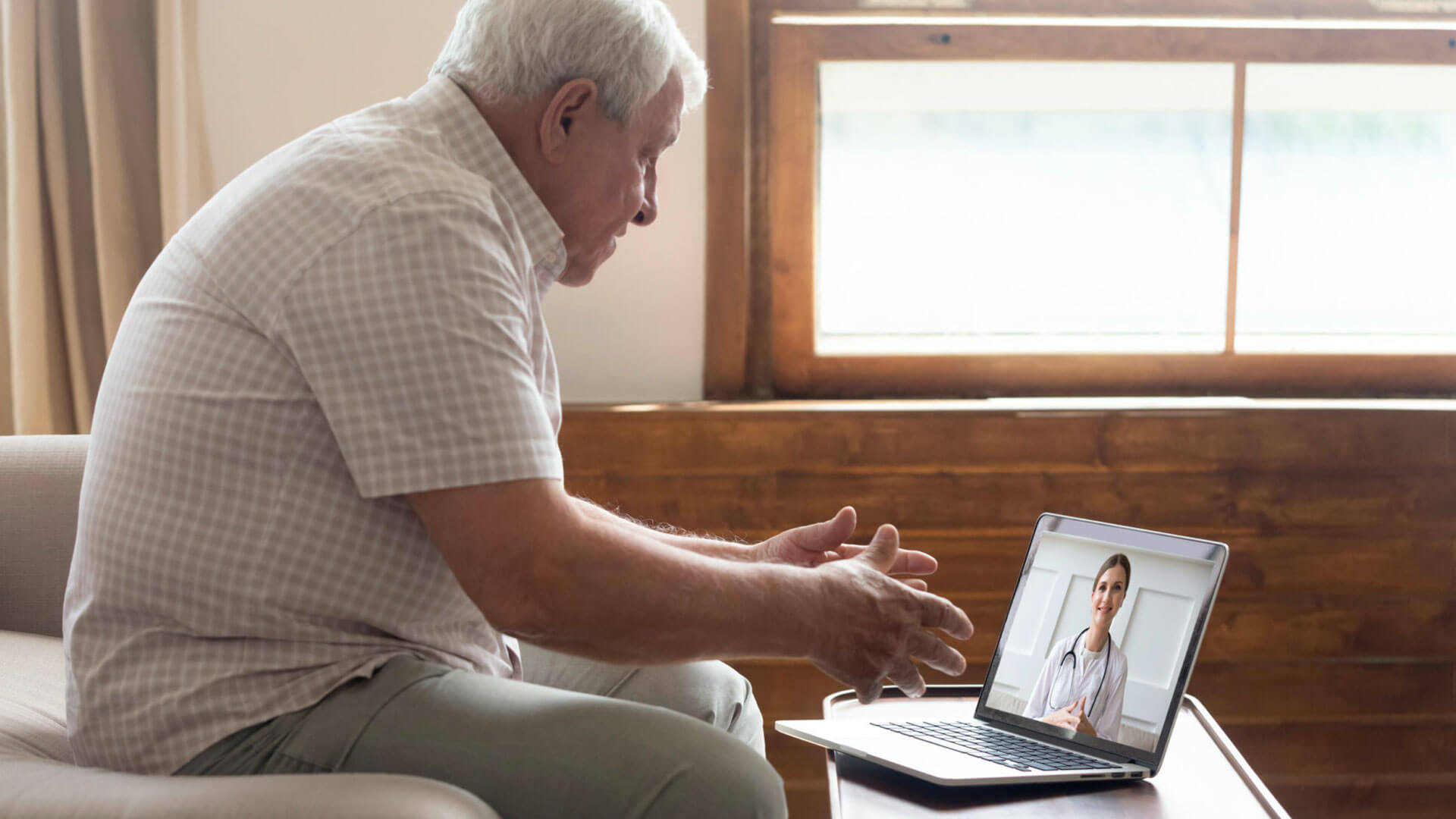 A patient speaking with his doctor via video conference (telemedicine).