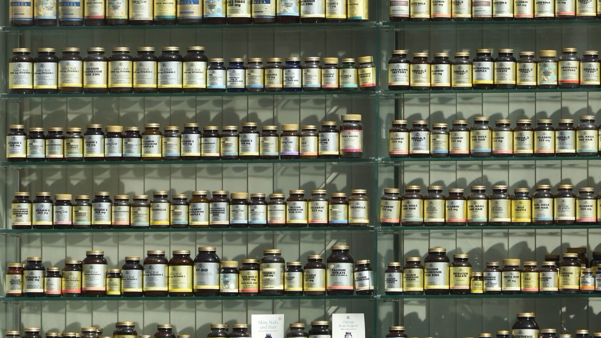 Shelving at a retail store full of dietary supplement products.