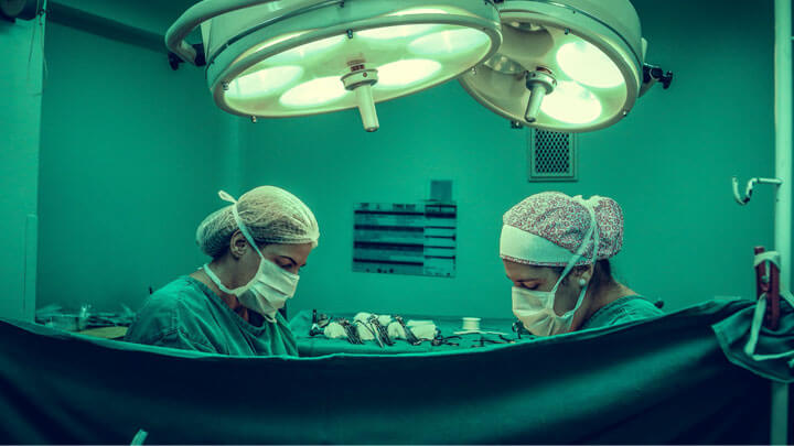 Two surgeons performing an operation.