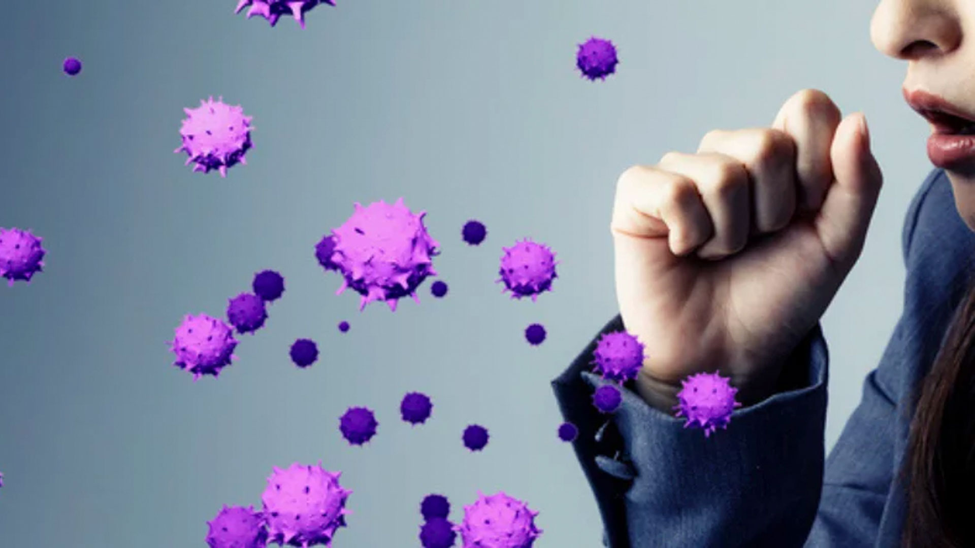 Person coughing with purple virus molecules floating around.