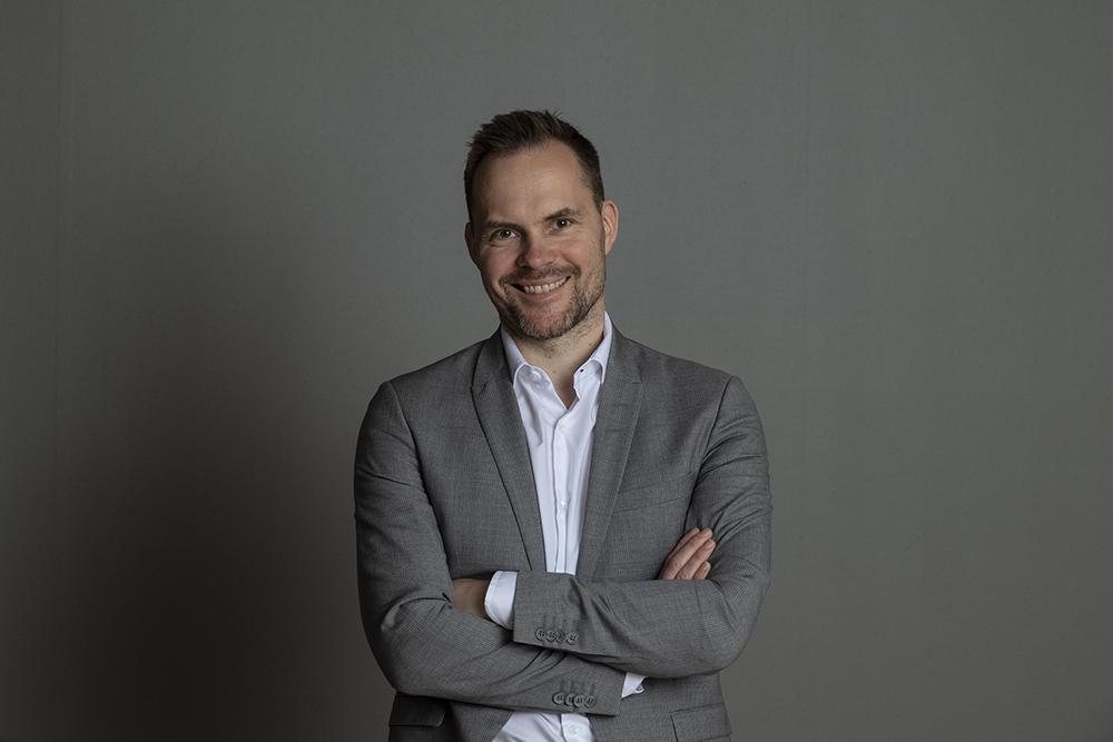 Portrettbilde av Hallgeir Skøien Varsi, partner og senior forretningsutvikler for tjenesteområde Strategi og organisasjon