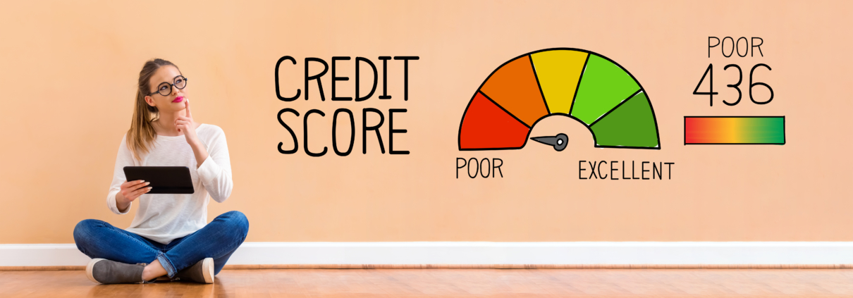 A girl sitting on the floor with her laptop pondering around her credit score