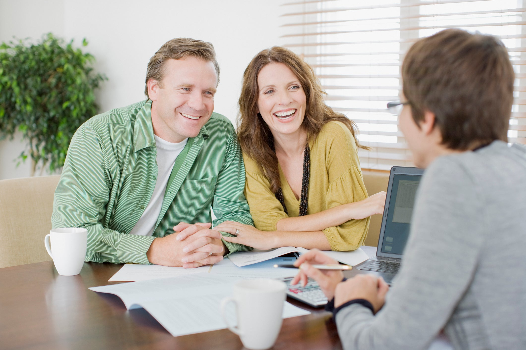 A couple meeting with a mortgage broker for advice