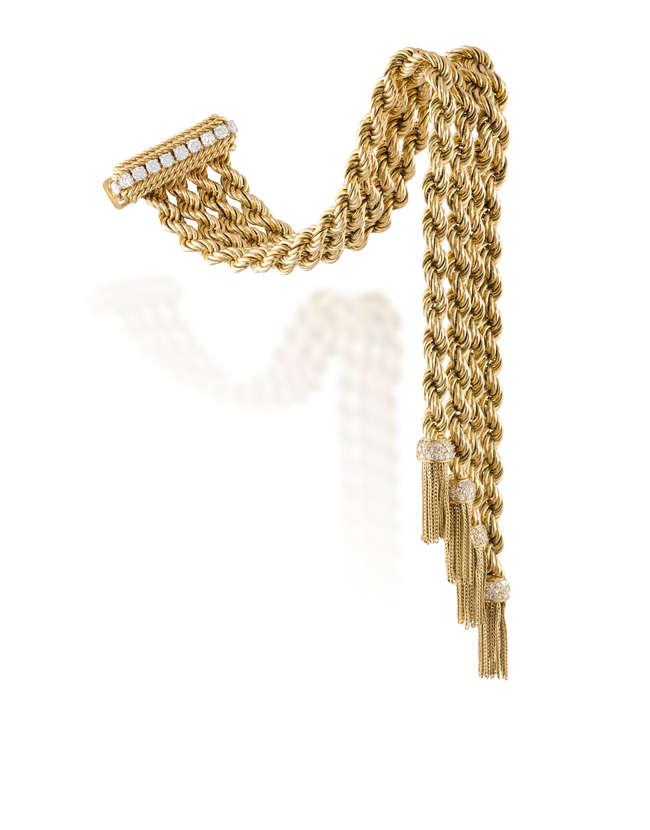 A DIAMOND AND GOLD 'CORDES LUDO' JARRETIERE BRACELET, BY VAN CLEEF & ARPELS, CIRCA 1945-50