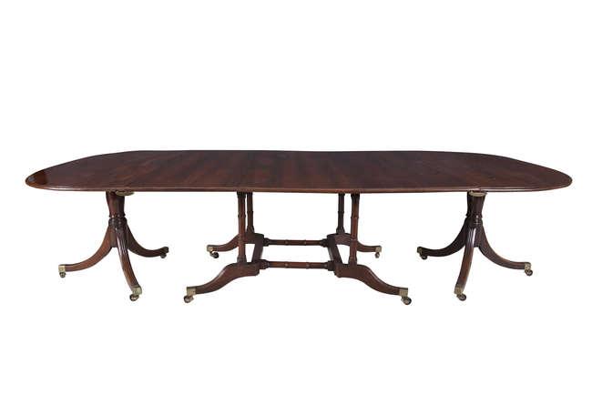 A REGENCY MAHOGANY CUMBERLAND-ACTION DINING TABLE