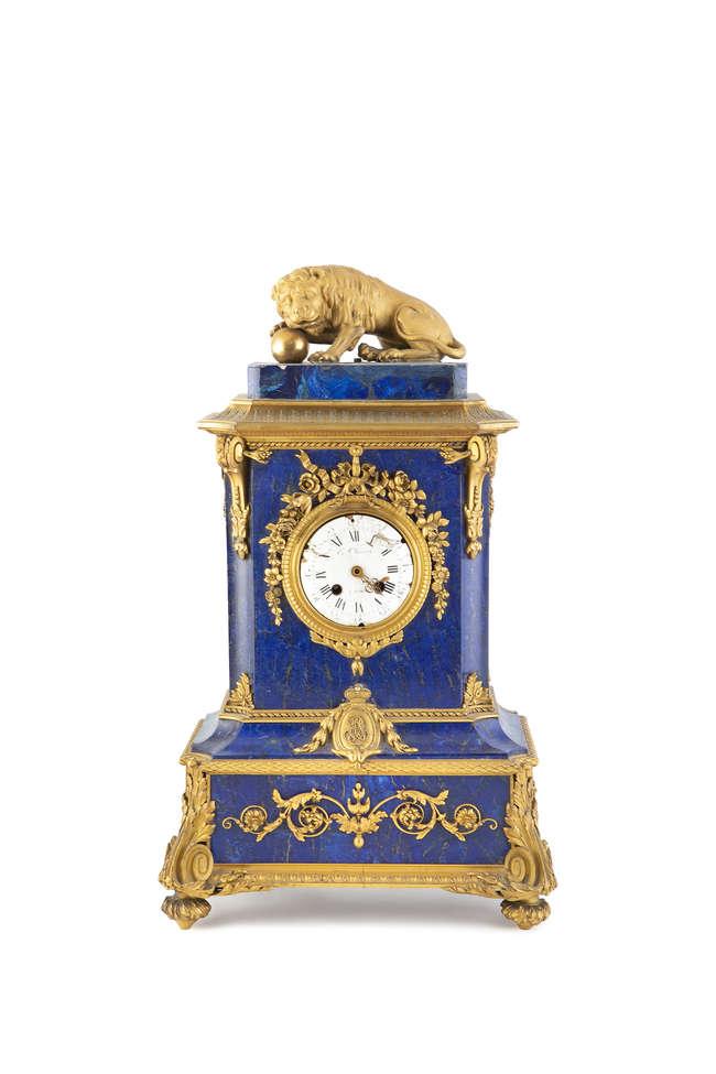 A LOUIS XV ORMOLU AND LAPIS LAZULI CASED MANTLE CLOCK