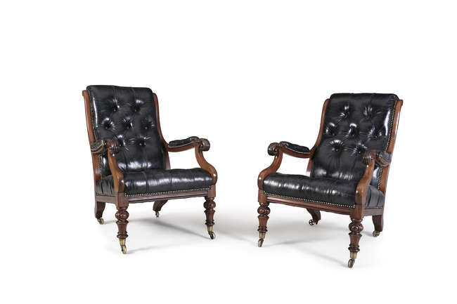 A PAIR OF IRISH EARLY VICTORIAN MAHOGANY FRAME LIBRARY ARMCHAIRS, by Strahan of Dublin