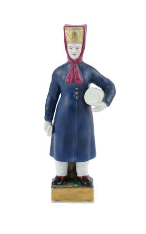 A RUSSIAN 'GARDNER' PORCELAIN FIGURE OF A BRIDE WITH HER DOWRY, Moscow 19th century