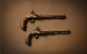 A PAIR OF 18TH/19TH CENTURY IRISH DUELLING PISTOLS by Obadiah Wisdom of Drogheda