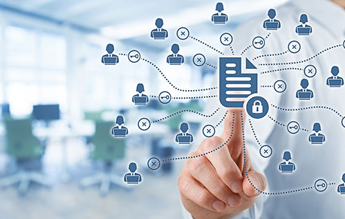 A man points to an outlined document icon with icons of people connected to it.