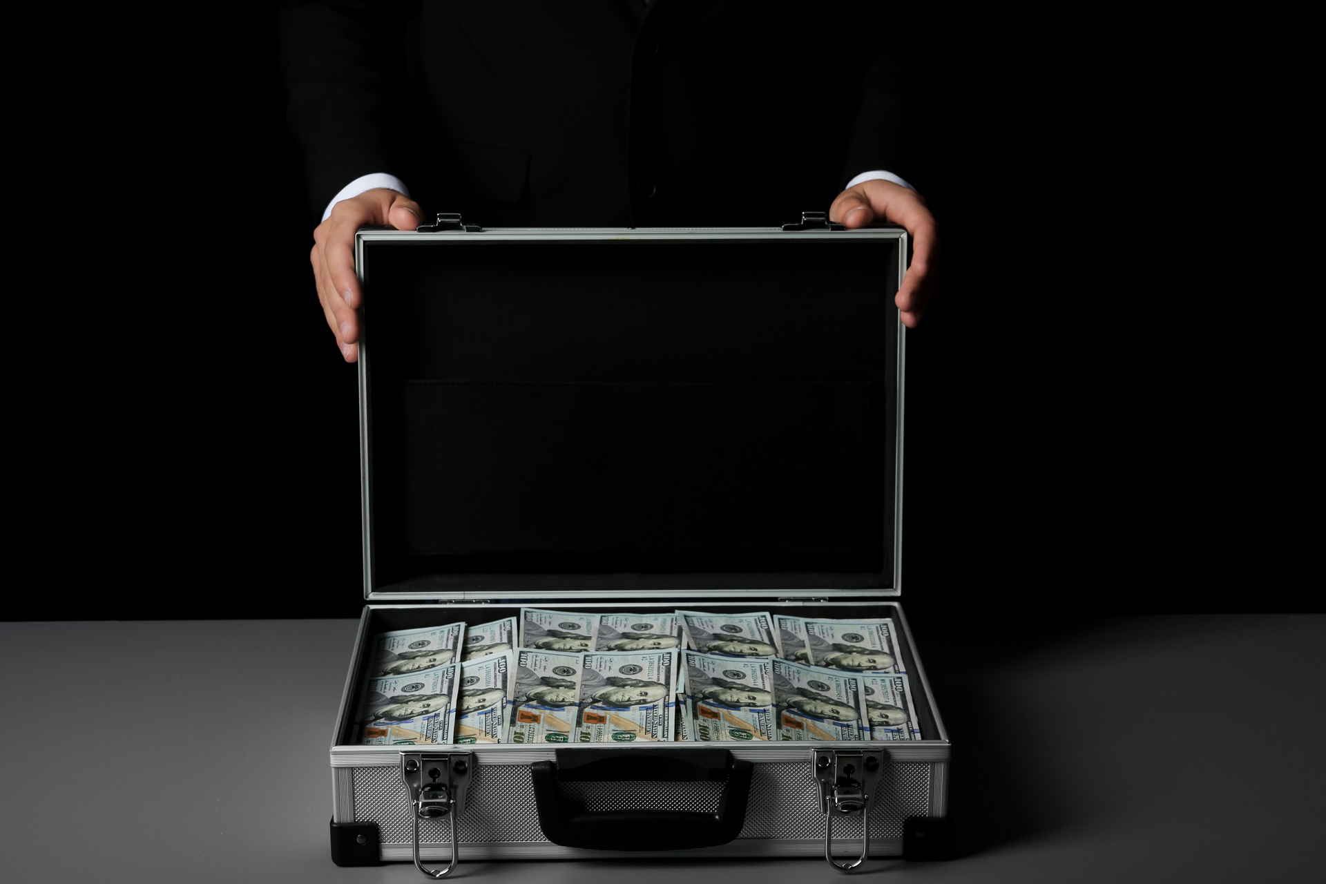 Picture of a suitcase full of cash