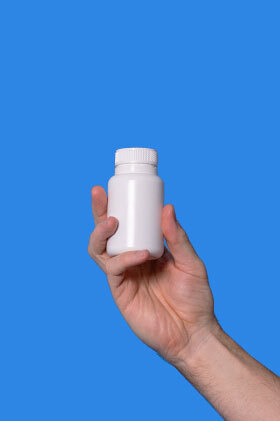 A Pilot pill container held up in the air