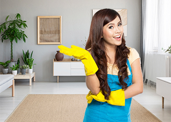 Photo of happy cleaner - Cleaning Services