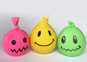 Balloons filled with sand with smiley faces drawn