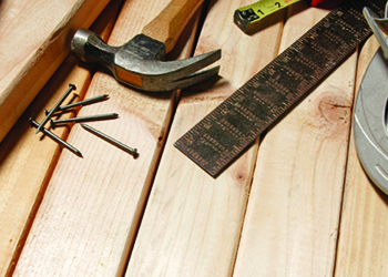 Carpentry tools on wooden decking