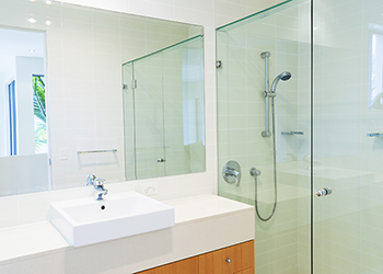 Bathroom featuring large glass mirror
