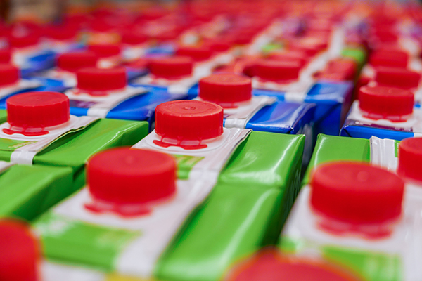 Rows of milk cartons with lids