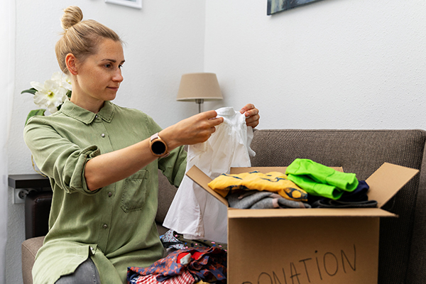 Lady sorting clothes for donation