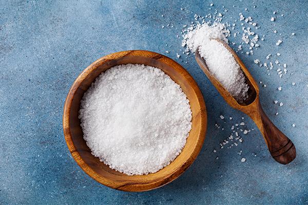 Wooden bowl full of salt
