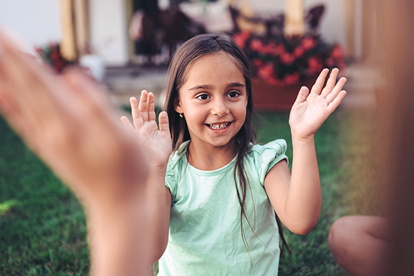 Young girl playing clapping game