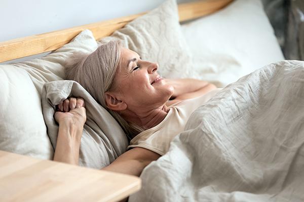 Woman waking from a good night's sleep