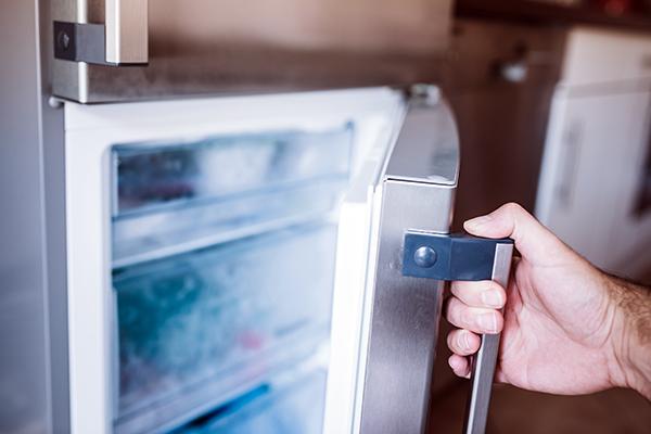 Man opening freezer door